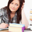 Attractive red-haired girl studying for an examination — Stock Photo #10595652