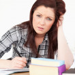 Attractive red-haired girl being upset while studying for an exa — Stock Photo #10595661