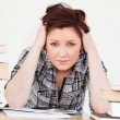 Good looking red-haired girl being upset while studying for an e — Stock Photo #10595685