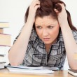 Attractive red-haired female being upset while studying for an e — Stock Photo