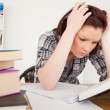 Attractive depresed female studying at her desk — Stock Photo #10596493