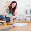 Good looking red-haired female nailing a plank at home — Stock Photo