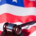 US flag and brown gavel — Stock Photo