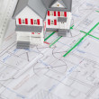 Close-up of toy house model and ruler on a plan - Stock Photo