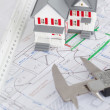 Top view of toy house model and caliper on a plan — Stock Photo