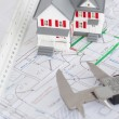 Stock Photo: Top view of toy house model and caliper on plan