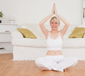 Delighted blond-haired woman practicing yoga — Stock Photo