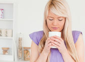 Gorgeous female drinking hot drink — Stock Photo