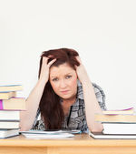 Beautiful red-haired female being depressed while studying for a — Stock Photo