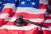 US flag and brown gavel — Stock Photo
