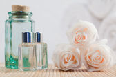 Roses and glass flasks — Stock Photo