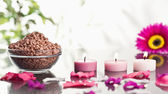 Lighted pink candles with petals and a bowl of gravel — Stock Photo