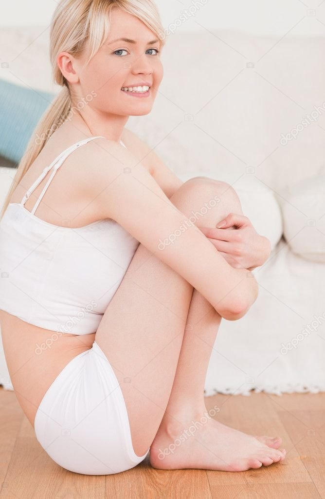 Attractive blond-haired woman doing fitness exercises in the living-room — Stock Photo #10590865