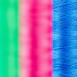 Colorful spools of thread - Stock Photo