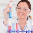 Portrait of a cute scientist storing a test tube — Stock Photo