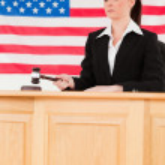 Focused judge knocking a gavel — Stock Photo #10601373