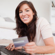 Young good looking female making a payment with a credit card on — Stock Photo #10602362