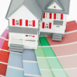 Close up of a maniature house and a color chart - Stock Photo