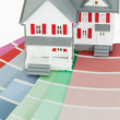 A maniature house on a color chart — Stockfoto