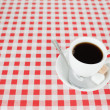 A cup of coffe on a tablecloth — Stock Photo #10603047