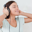 Charming brunette listening to music — Stock Photo #10603144