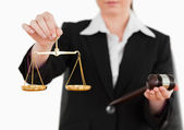 Woman holding a gavel and scales of justice — Stock Photo