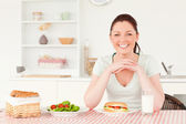 Good looking woman ready to eat a sandwich for lunch — Stock Photo