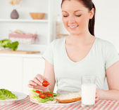 Charming woman ready to eat a sandwich for lunch — Stock Photo