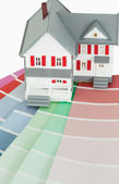 A maniature house on a color chart — Stock Photo