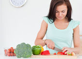 Woman chopping vegetables — Stock Photo