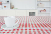 A cup of tea on a tablecloth — Stock Photo