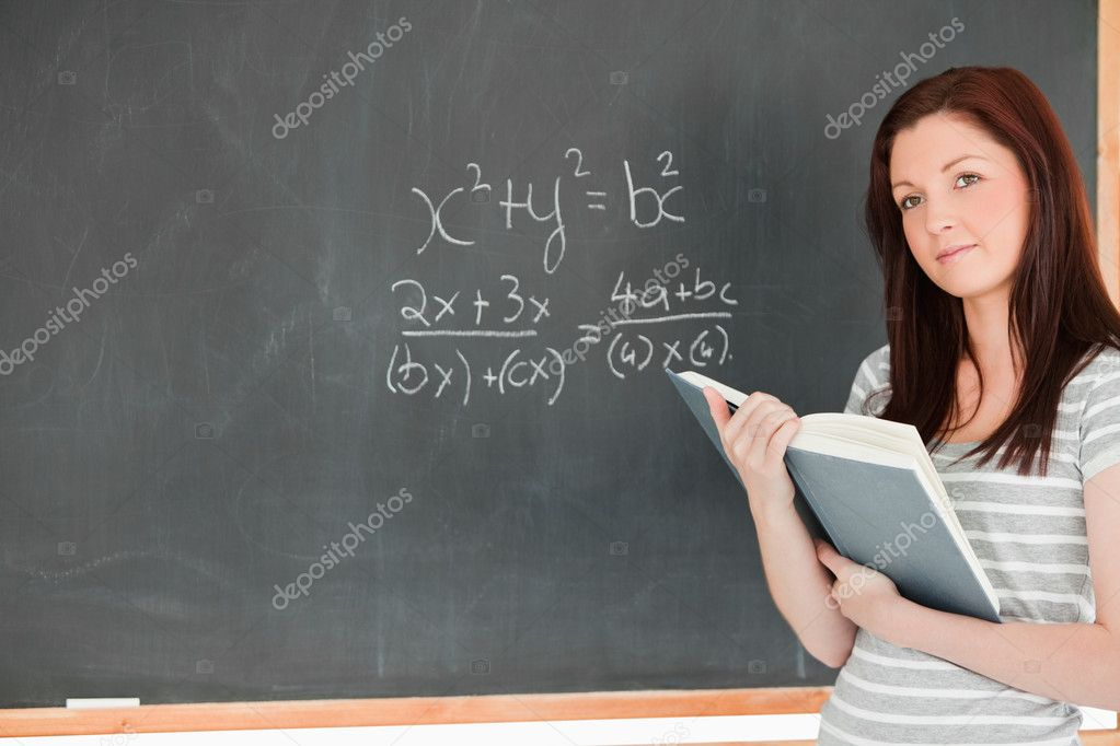 Gorgeous student solving an equation in a classroom — Stock Photo #10601409