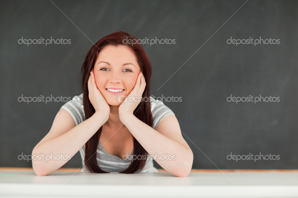 Portrait of a young student in a classroom — Stock Photo #10601577