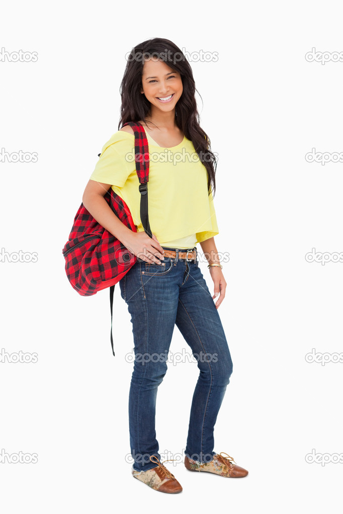 Pretty Latin student posing with a backpack against white background — Stock Photo #9785067