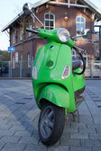 Motor scooter on background of old dutch building — Stock Photo