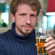 Portrait of smiling man with glass of beer — Stock Photo