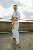 Judoka teen boy training judo on the sky background — Stock Photo