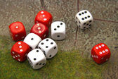 Red and white dices on the playing field — Stock Photo