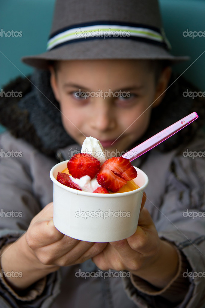 Cute teenage boy with ice cream(strawberry topping)  Stock Photo #9925926