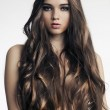 Beautiful woman with perfect skin and long curly hair — Stock Photo