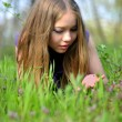 Portrait of a girl in green grass — Stock Photo