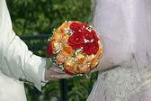 Red, orange and white wedding bouquet — Stock Photo