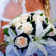 Stock Photo: Bride holding bridal bouquet close up