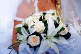 Bride holding bridal bouquet close up — Stock Photo