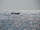 Boat and Glittering Sea — Stock Photo