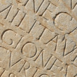 Royalty-Free Stock Photo: Roman Writing as Background