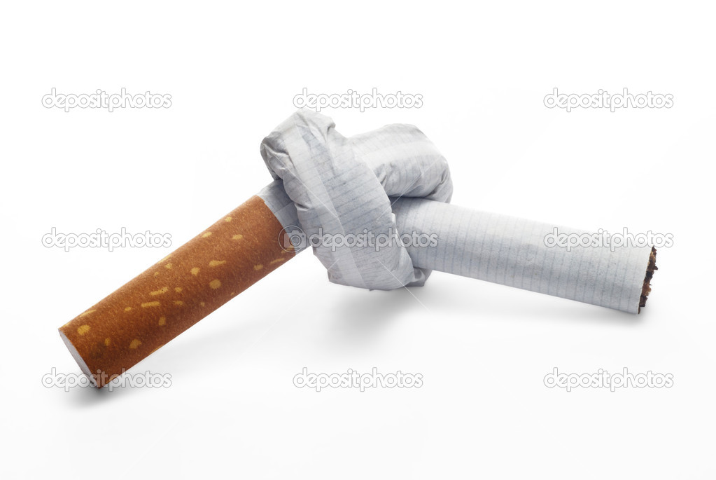 A cigarette with a knot  Stock Photo #9800770