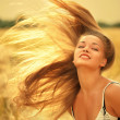 Stock Photo: Woman with magnificent hair