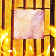 Royalty-Free Stock Photo: Empty poster burning under fire