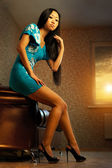 Beautiful asian woman relaxing on sofa in room — Stok fotoğraf